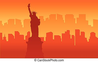 Silhouette of liberty building at sunset