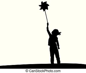 Silhouette of litte girl playing with pinwheel