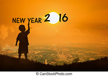 Silhouette of little boy see sunset new year 2016