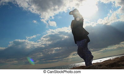 """""""Silhouette of lonely woman standing on seashore in sunlight, broken relationship"""""""