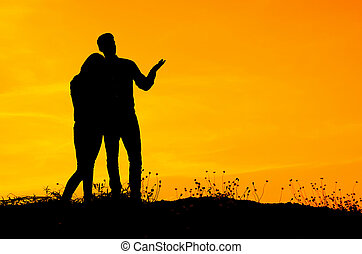 Silhouette of lover with sun set