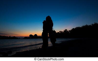 Silhouette of Lovers hug