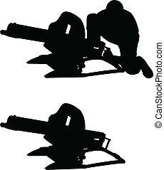 silhouette of machine gun