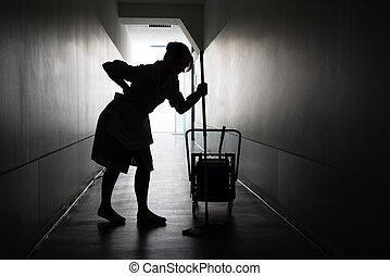 Silhouette Of Maid Suffering From Backache - Silhouette Of...