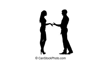 Silhouette of man kissing woman's hand. Slow motion