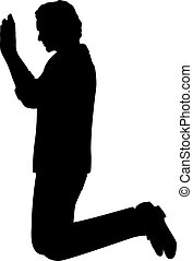 Silhouette of man kneeling with raised hands