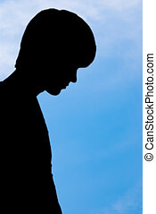 Silhouette of man on sky background.