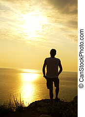 silhouette of man on the sunset