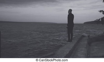 silhouette of man on the water