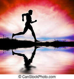 Silhouette of man running at sunset
