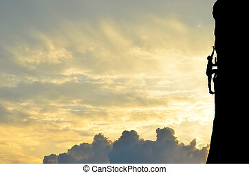 silhouette of man - silhouette of a climber conquers the top...