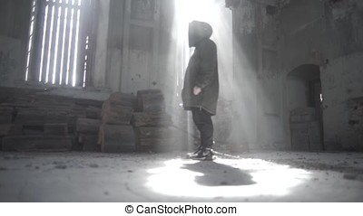 Silhouette of man standing on window front in the abandoned building. Footage. Silhouette of a Man with on a old house with window