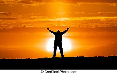 Silhouette of man and big sun. Conceptual scene.