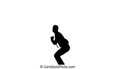 Silhouette of man with a tie jumpin