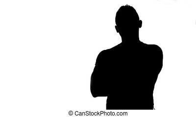 Silhouette of man with arms crossed