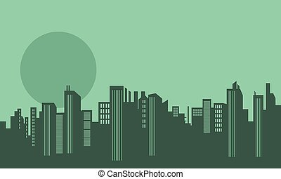 Silhouette of many buildings and moon