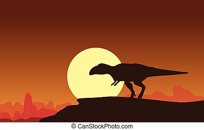 Silhouette of Mapusaurus at the sunset