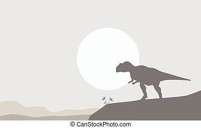 Silhouette of mapusaurus on the cliff