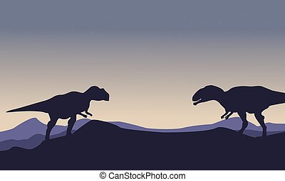 Silhouette of mapusaurus on the hill scenery