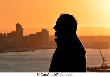 Silhouette of mature man