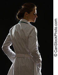 Silhouette of medical doctor woman looking on copy space