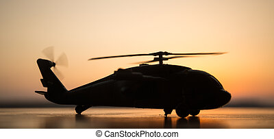 silhouette of military helicopter at sunset. Artwork decoration.