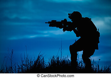 Silhouette of military soldier or officer with weapons at...