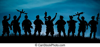 Silhouette of military soldiers team or officer with weapons...