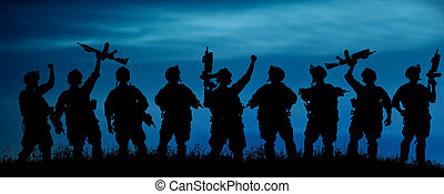 Silhouette of military team soldiers or officers with weapons at night.