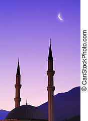 Silhouette of mosque and moon over sky. Turkey, Kemer,...