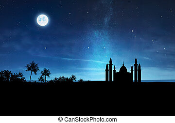 Silhouette of mosque with high minaret
