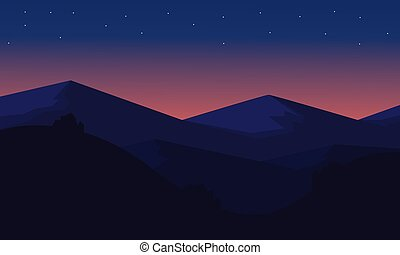 Silhouette of mountain at night
