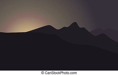 Silhouette of mountain at the sunrise