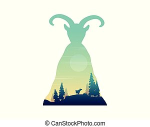 Silhouette of mountain goat on the hill landscape
