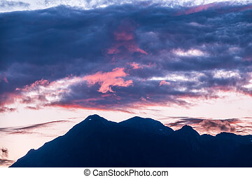 Silhouette of mountain range at pink sunset