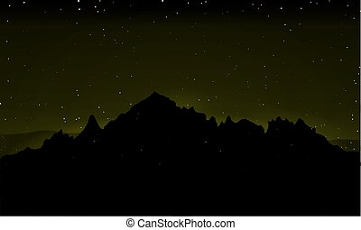 Silhouette of mountains against the background of the night sky