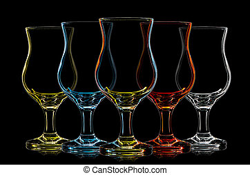 Silhouette of multicolor cocktail glass on black