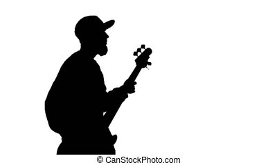 Silhouette of musician with bass guitar