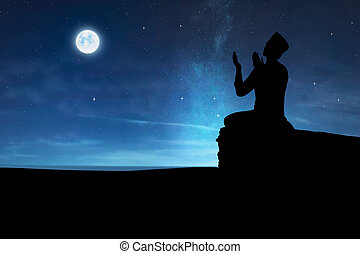 Silhouette of muslim man praying to god