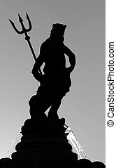 silhouette of Neptune with trident - fountain in Trento,...