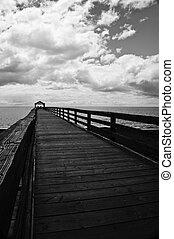 Silhouette of ocean pier