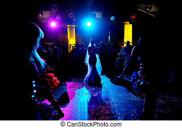 Silhouette of of bride dancing on the dance floor