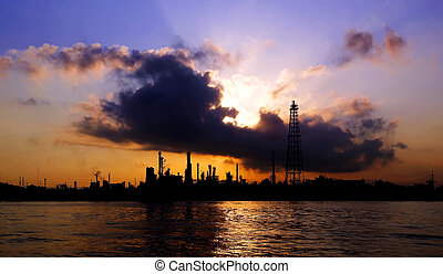 Silhouette of oil refinery