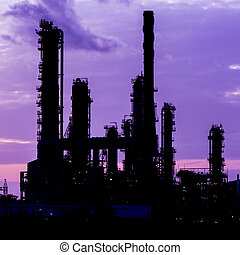 silhouette of oil refinery plant at twilight morning