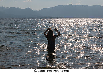 Silhouette of One Young Girl in the Water