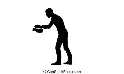 Silhouette of operator make videotaping, camera at waist...