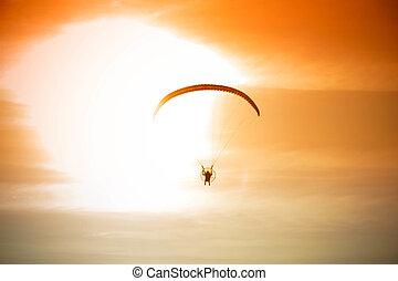 silhouette of para motor glider