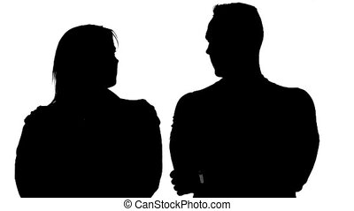 Silhouette of partners - man and woman on white background