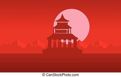 Silhouette of pavilion with big moon