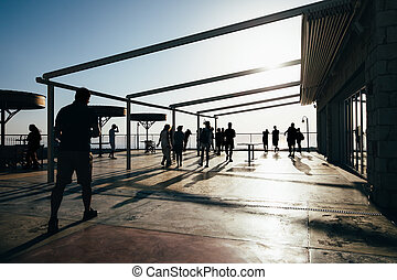 Silhouette of people walking on terrace
